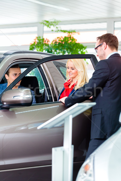 Couple buying new car at dealership Stock photo © Kzenon