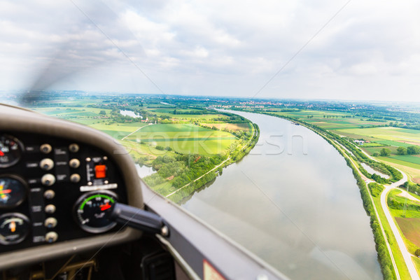 View from a flying sport plane over river landscape Stock photo © Kzenon