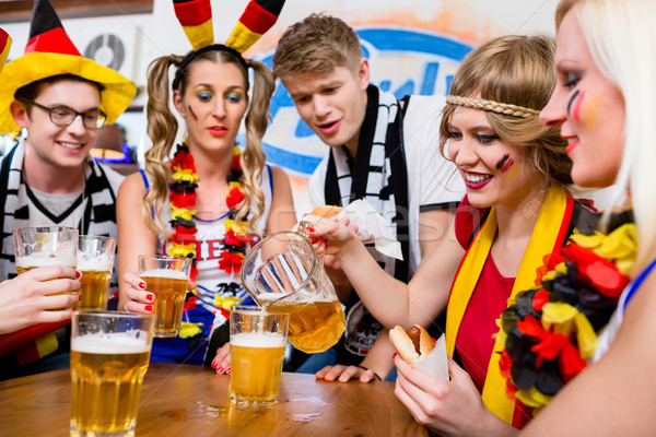 Football fans watching a game of the German national team  Stock photo © Kzenon