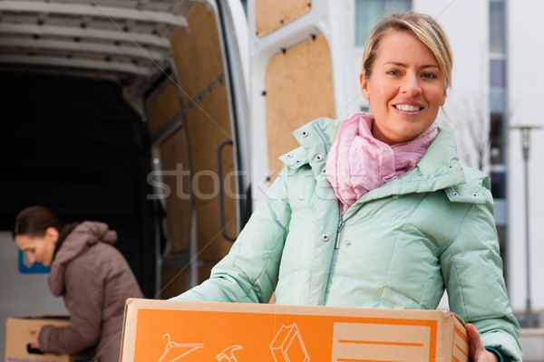 Female friends loading a moving truck Stock photo © Kzenon