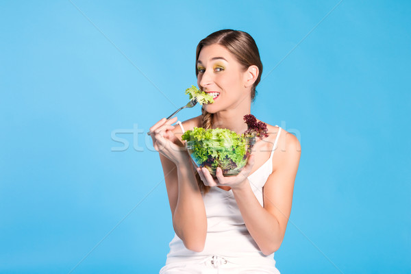 Healthy nutrition - young woman with salad Stock photo © Kzenon