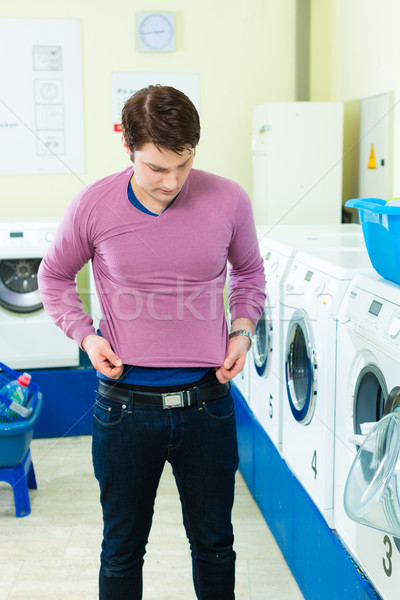 Student in a laundry with shrunk pullover Stock photo © Kzenon