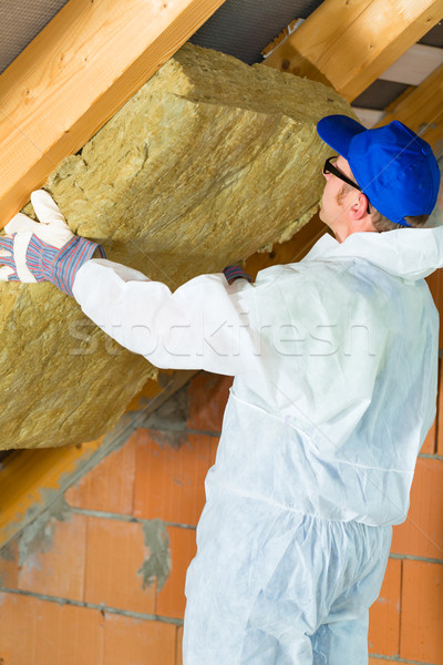 Worker setting thermal insulating material Stock photo © Kzenon