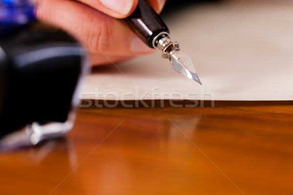 person writing a letter with pen and ink Stock photo © Kzenon