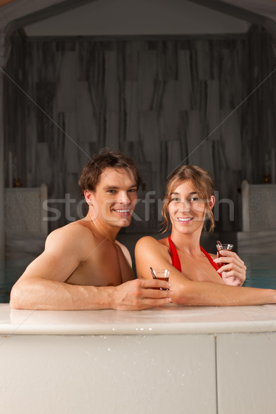 Couple drinking tea in swimming pool Stock photo © Kzenon