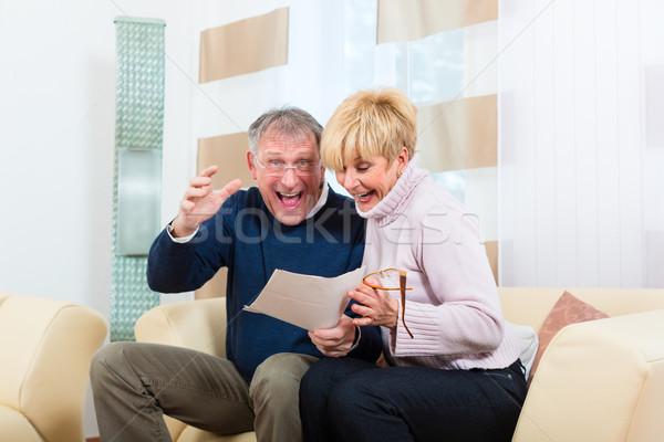 Seniors at home receiving a good letter Stock photo © Kzenon