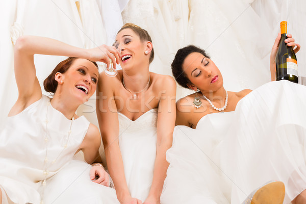 Brides drinking too much in wedding shop or store Stock photo © Kzenon