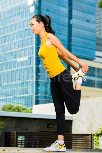 Urban woman sports - fitness in Asian city Stock photo © Kzenon