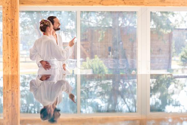 Couple enjoying view on wellness spa pool Stock photo © Kzenon