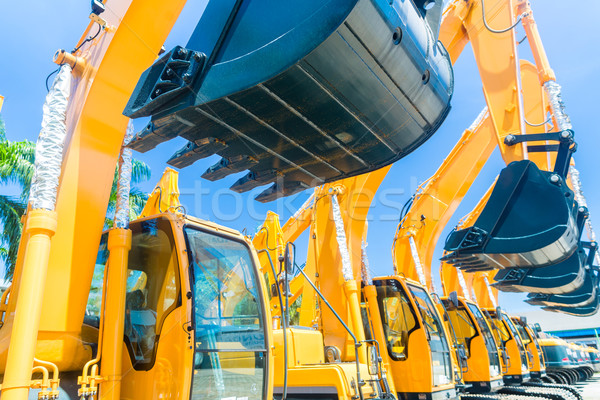 Shovel excavator on Asian machinery  rental company Stock photo © Kzenon