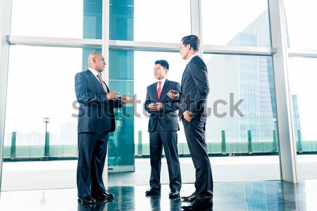 Business team having agreement and handshake Stock photo © Kzenon