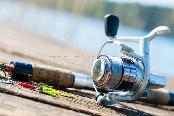 fishing rod on jetty close to lake Stock photo © Kzenon