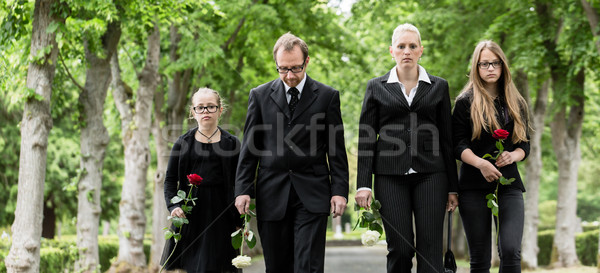 Family walking down alley at graveyard Stock photo © Kzenon