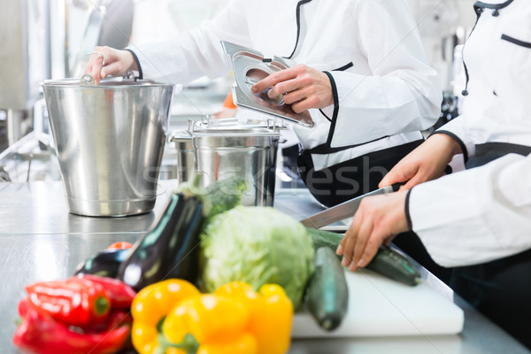 chefs preparing meals in commercial kitchen Stock photo © Kzenon