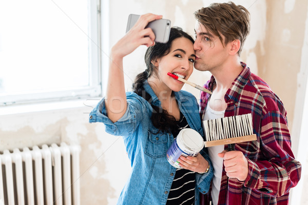 Young couple making a selfie while working to the renovation of  Stock photo © Kzenon