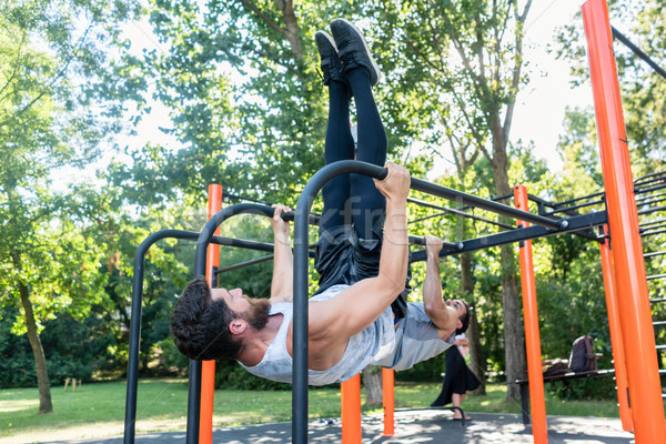 Two muscular young men practicing calisthenics workout in an out Stock photo © Kzenon