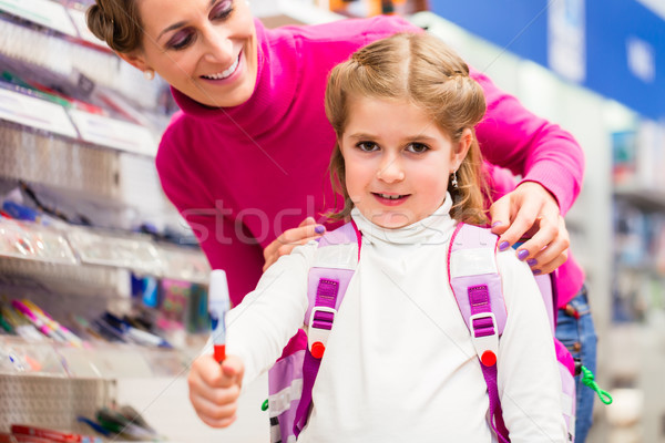 Family buying school supplies in stationery store Stock photo © Kzenon