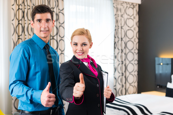 Hotel manager welcoming guest showing room Stock photo © Kzenon