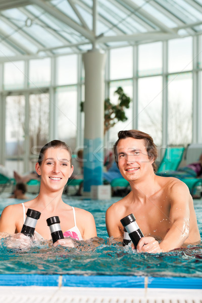 Fitness - gymnastics under water in swimming pool Stock photo © Kzenon