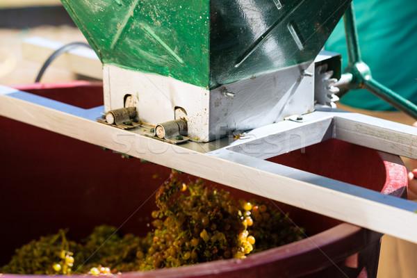 Grape harvesting machine or juicer at work Stock photo © Kzenon
