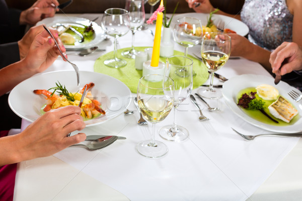 People fine dining in elegant restaurant Stock photo © Kzenon
