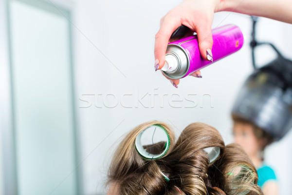 Hairdresser - hair stylist curling hairs Stock photo © Kzenon