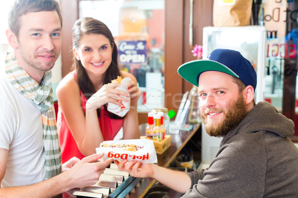 Customers eating Hotdog in fast food snack bar Stock photo © Kzenon