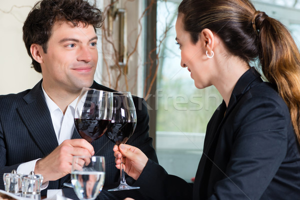 Businesspeople have a lunch in restaurant Stock photo © Kzenon
