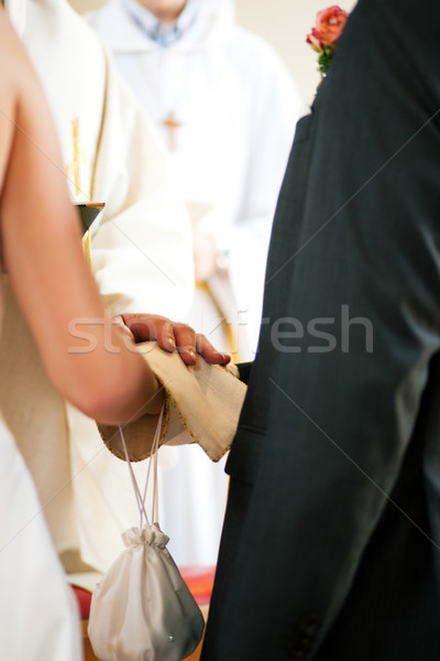 Wedding couple receiving blessing from priest Stock photo © Kzenon