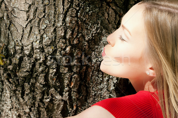 Girl kissing tree Stock photo © Kzenon