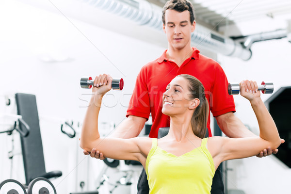 Personal trainer in gym for better fitness Stock photo © Kzenon