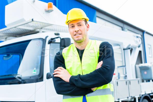crane operator in front of truck on site Stock photo © Kzenon