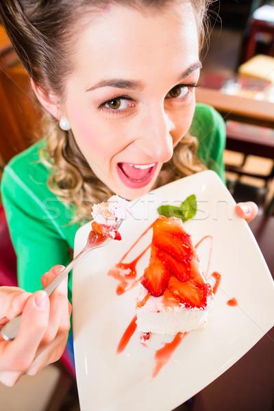 Woman eating cake at pastry shop cafe Stock photo © Kzenon