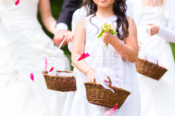 Wedding bridesmaids with flower petal basket Stock photo © Kzenon