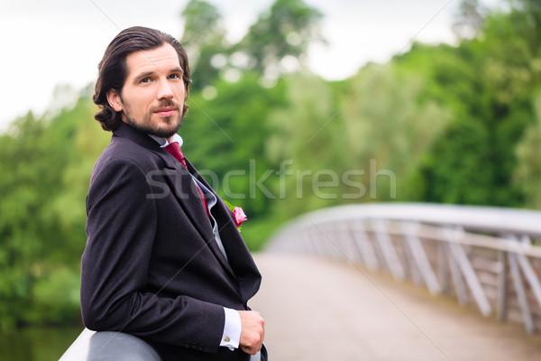 Wedding Groom on bridge Stock photo © Kzenon