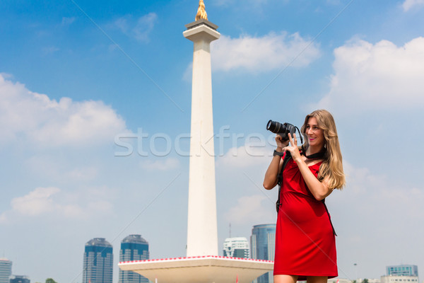 Tourist with camera sightseeing at Monumen Nasional  Stock photo © Kzenon