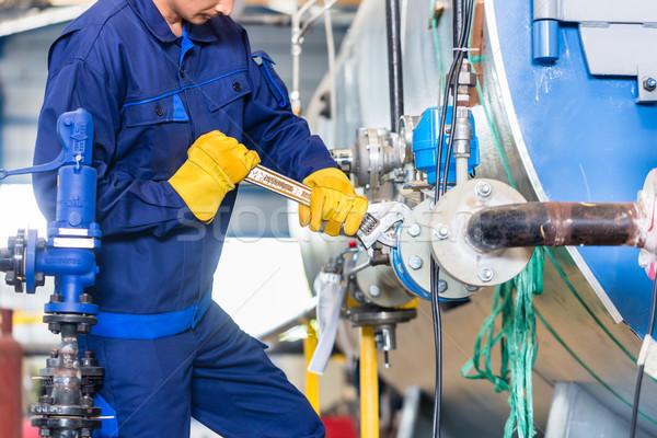 Mechanic repairing machine in industrial plant Stock photo © Kzenon