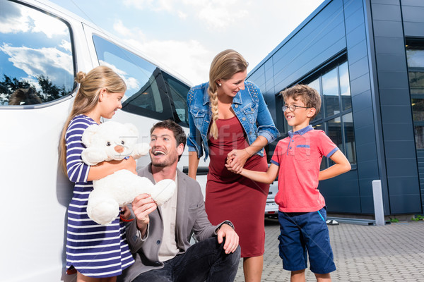Family with children buying auto at car dealer Stock photo © Kzenon