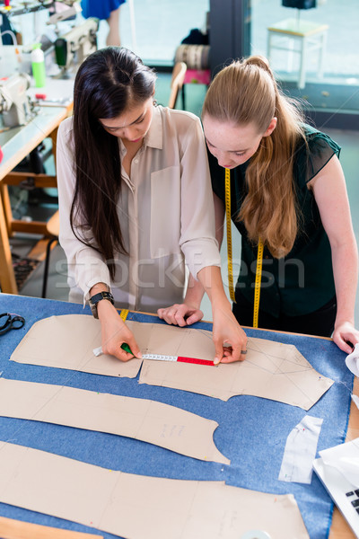 Young fashion designers talking about layout Stock photo © Kzenon