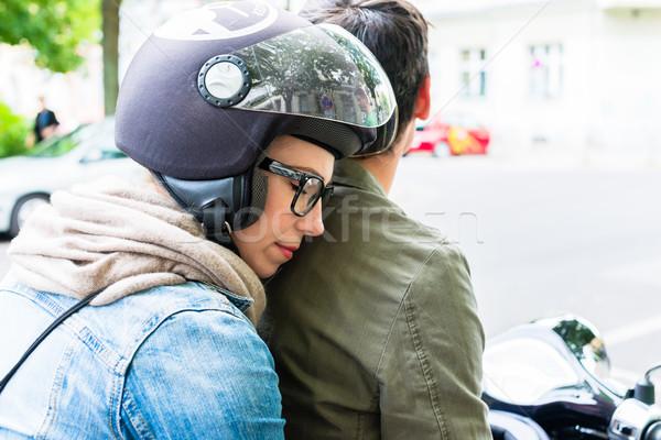 Kadın oturma koltuk vespa genç kadın kask Stok fotoğraf © Kzenon