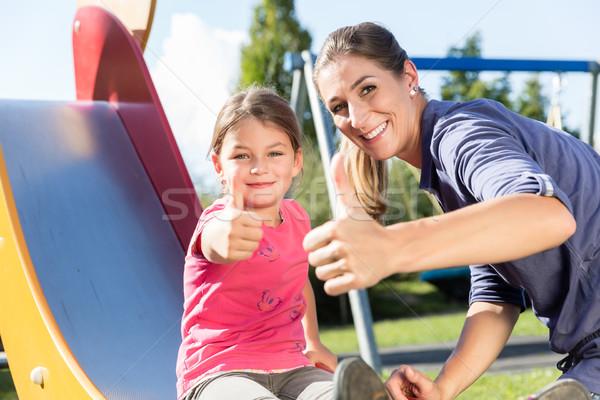 Mère petite fille aventure aire de jeux parc femme Photo stock © Kzenon
