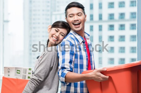 Asian couple after relocation to new apartment  Stock photo © Kzenon