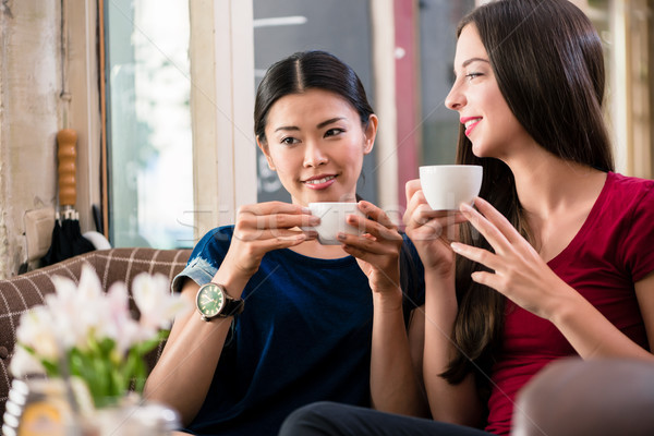 Young woman daydreaming while drinking a cup of coffee Stock photo © Kzenon