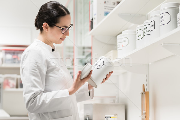 Pharmacist checking a chemical pharmaceutical substance Stock photo © Kzenon