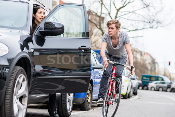Young bicyclist shouting while swerving for avoiding dangerous collision Stock photo © Kzenon