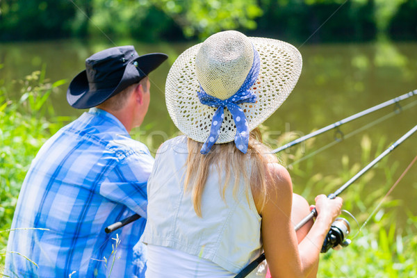 Couple, woman and man, with fishing rods sport angling Stock photo © Kzenon