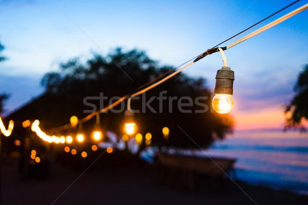 Strand promenade nacht partij lichten zonsondergang Stockfoto © Kzenon
