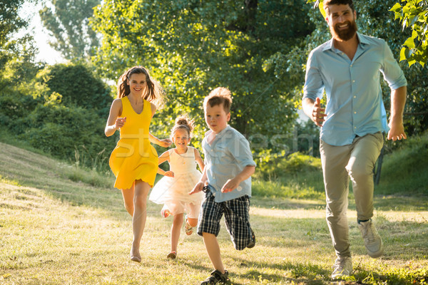 Active young parents with a healthy lifestyle running together Stock photo © Kzenon
