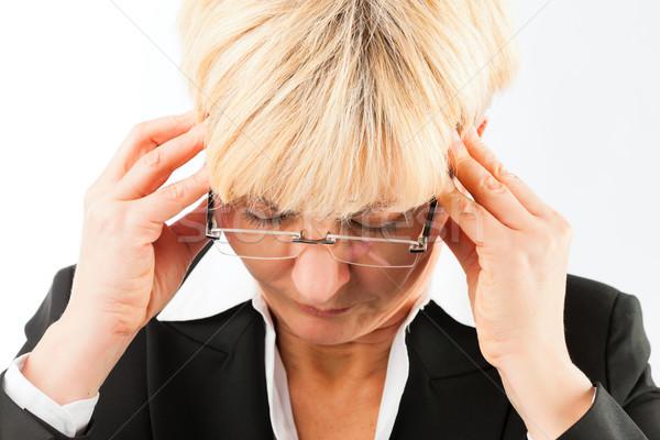 Business woman with headache or burnout Stock photo © Kzenon
