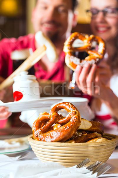 People in Bavarian Tracht eating in restaurant or pub Stock photo © Kzenon